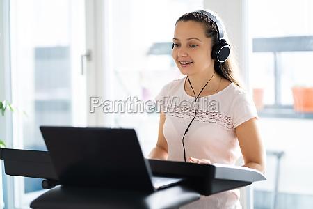 woman playing music keyboard piano