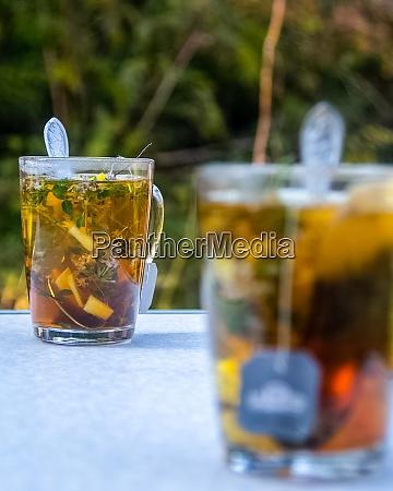 transparent mug with tea brewing tea