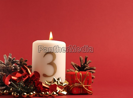 white candle with the number three
