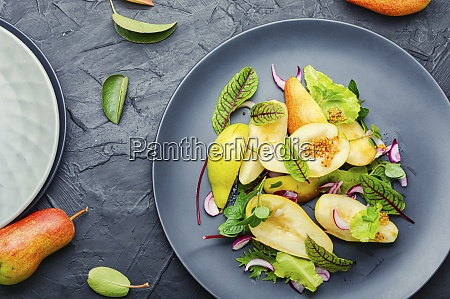 healthy vegetarian salad with pear