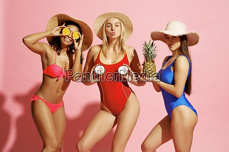 sexy women in swimsuits and hats