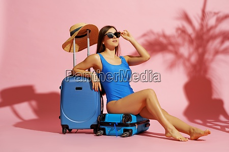 glamour woman in swimsuit sitting on