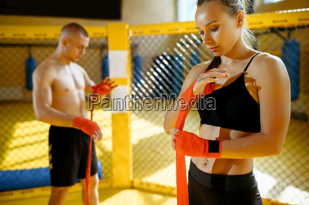 male and female mma fighters wraps