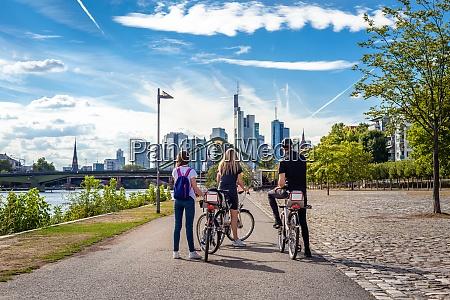 tourists on bikes explore the skyline