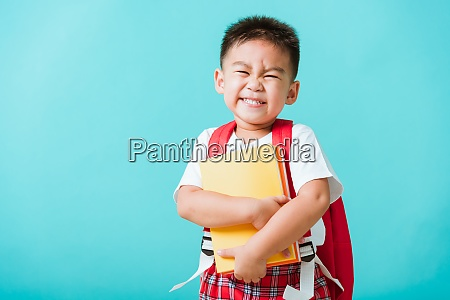 kid from preschool kindergarten with book