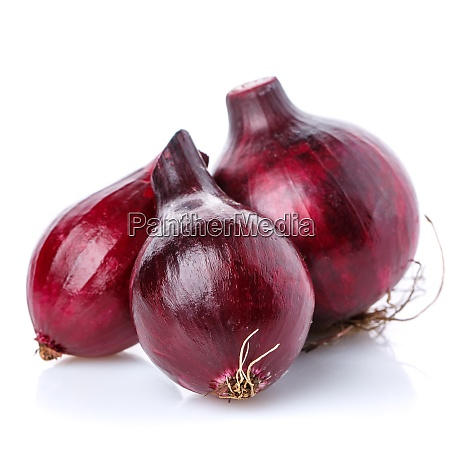 three red onions on a white