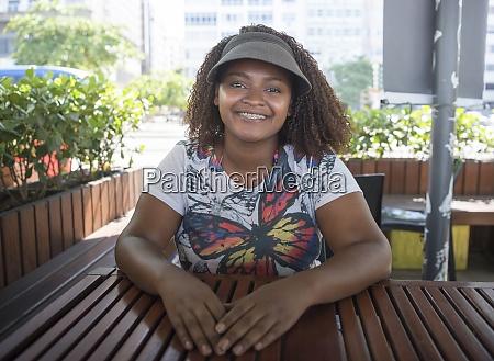 cute brazilian girl sunbathes on copacabana