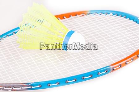 the shuttlecock on badminton racket closeup