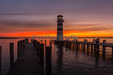 lighthouse with lantern on a jetty
