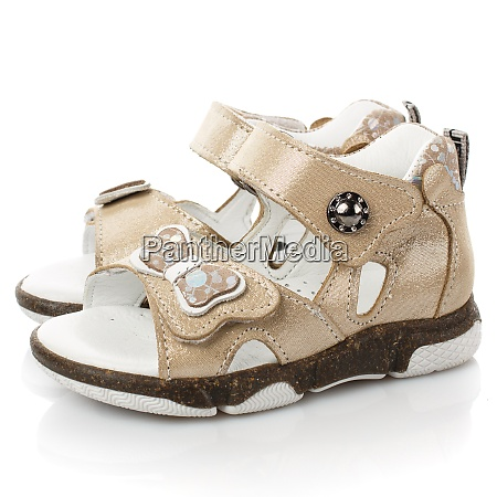 pair of beige sandals for little