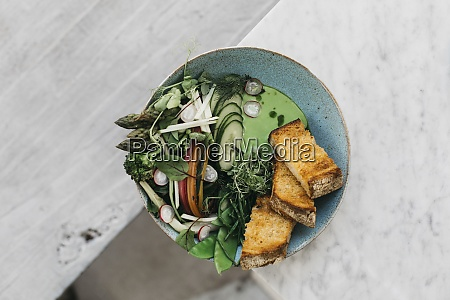 green vegetables and toast on edge