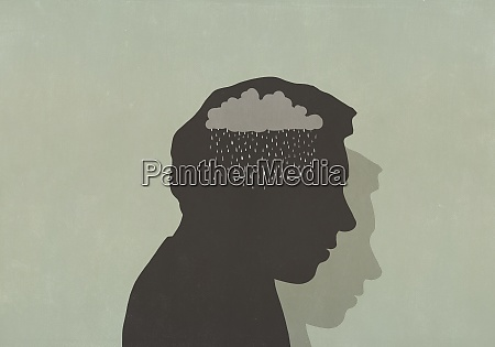 silhouette of sad man with rain