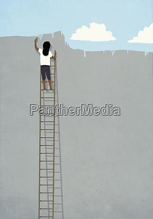 woman on ladder painting blue sky