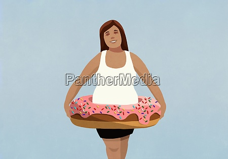 portrait overweight woman wearing inflatable donut