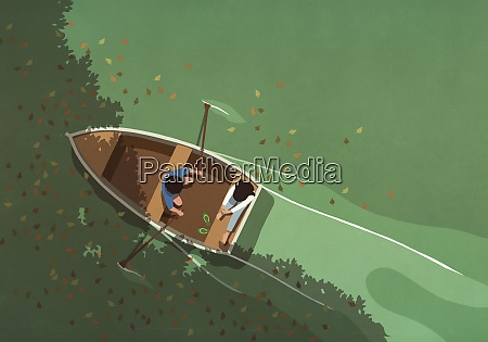 autumn leaves falling around couple in