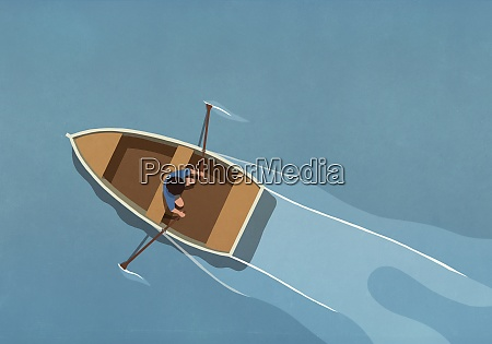 man in rowboat on water