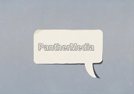 blank speech bubble on blue background