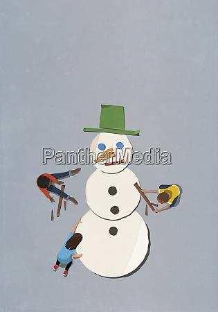 kids assembling paper snowman