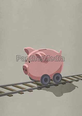 piggy bank on wheels rolling on