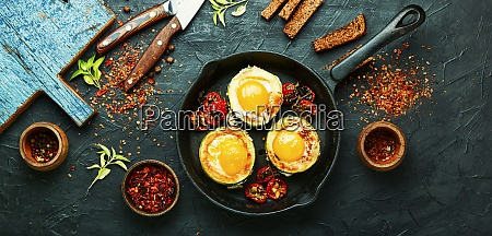 scrambled eggs on frying pan