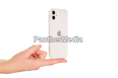 female hand presenting the new iphone