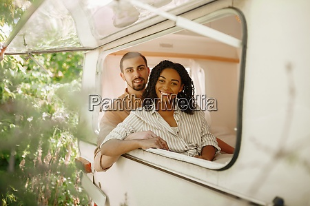 couple looks out of rv window