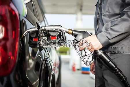 man fueling up a car