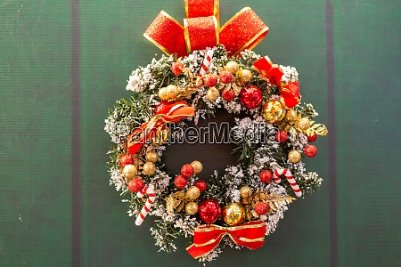 christmas wreath decoration at green door