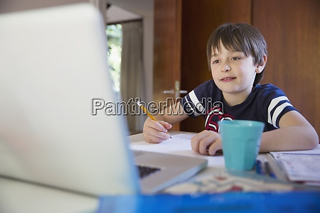boy e learning at laptop