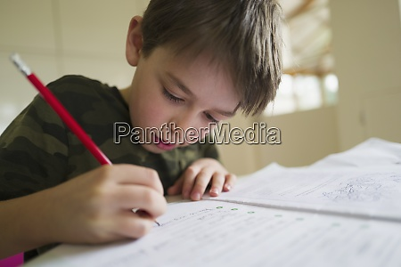 close up focused boy home schooling