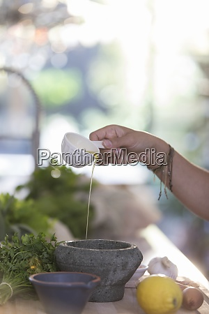 woman cooking with olive oil and
