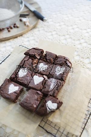 powdered sugar hearts on brownies on