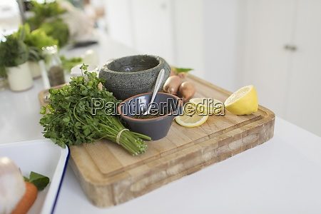 cilantro and lemons on cutting board