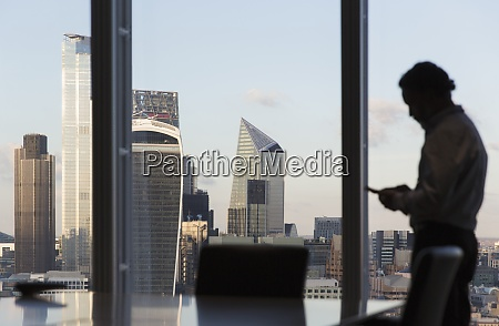 businessman using smart phone at highrise