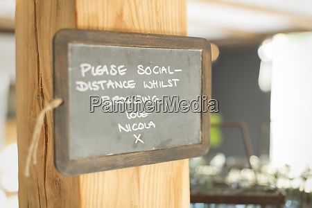 blackboard social distancing sign in small