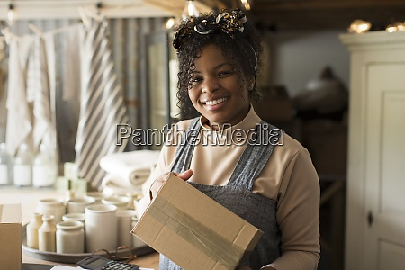 portrait happy female shop owner with