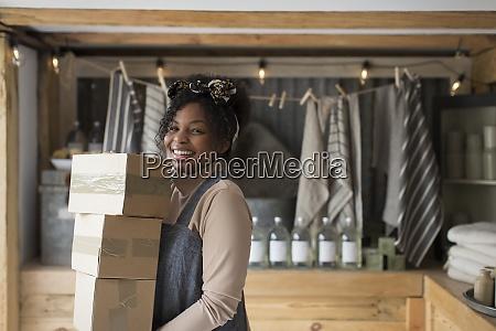 portrait confident female shop owner carrying