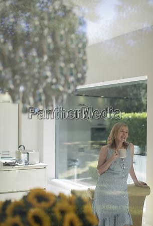 senior woman drinking tea in sunny