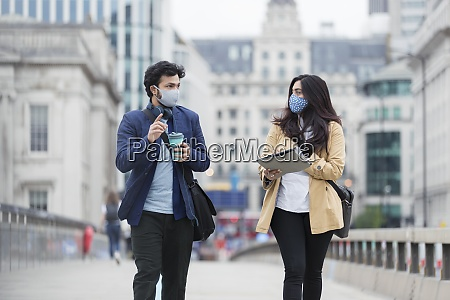 business people in face masks talking