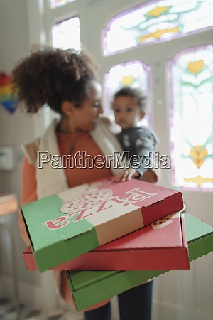 mother and baby daughter receiving pizza