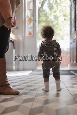 baby girl in star pajamas at