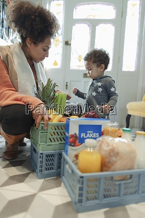 mother and baby daughter receiving grocery
