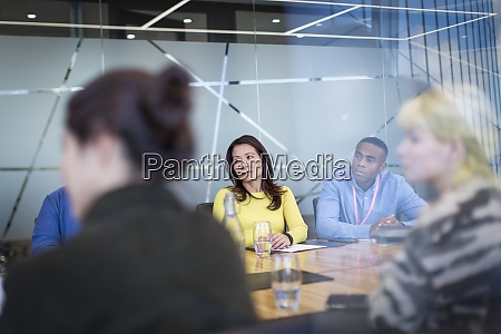 business people listening in conference room