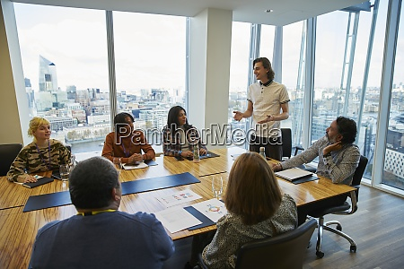 businessman leading conference room meeting in