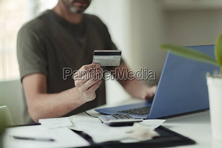 man with credit card online shopping