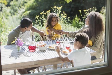 happy family enjoying lunch on sunny