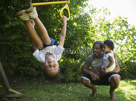 happy family playing in summer backyard