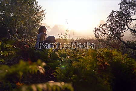 serene young couple with binoculars in