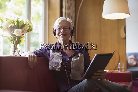portrait happy senior woman with headphones