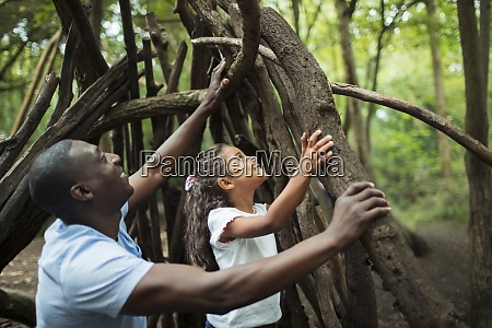 father and daughter making teepee with